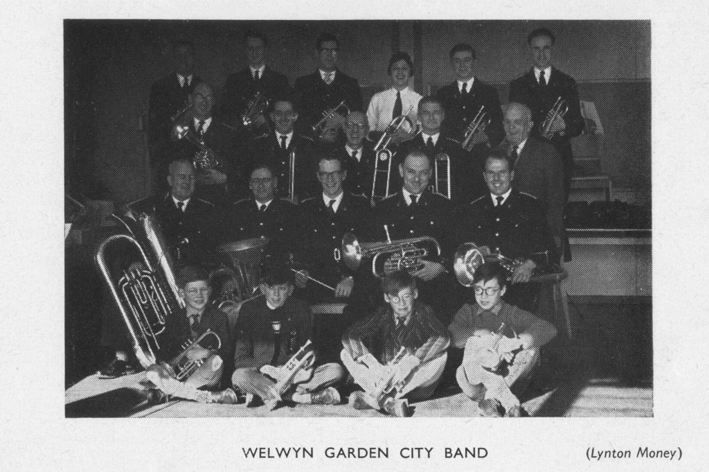 WGC Band from 1960 WGC Youth Handbook. Listing reads: WELWYN GARDEN CITY BAND Times of Meeting : Rehearsals at Heronswood Secondary Modern School, Thurs 8 pm; Sun 11 am. Membership: Anyone interested. Suitable applicants are taught to play an instrument and are given an instrument and uniform for use with the band. Activities: Twice weekly rehearsals. Concerts given in public throughout the summer on various open spaces and some indoor concerts during the winter. Occasionally the band goes to compete in contests (at least once a year, sometimes twice). Objects: Generally to provide the pleasure of playing together in a more flexible combination than a normal orchestra, as one player can usually play on any instrument. Subscription : Junior members 3d. per week, seniors 6d. per week. Secretary: Mr. R. H. Jones, 41 Archer's Ride, Welwyn Garden City.